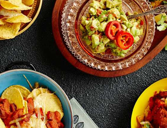 Nachos with Chorizo, Caramelised Pineapple Salsa and Red Chili Guacamole